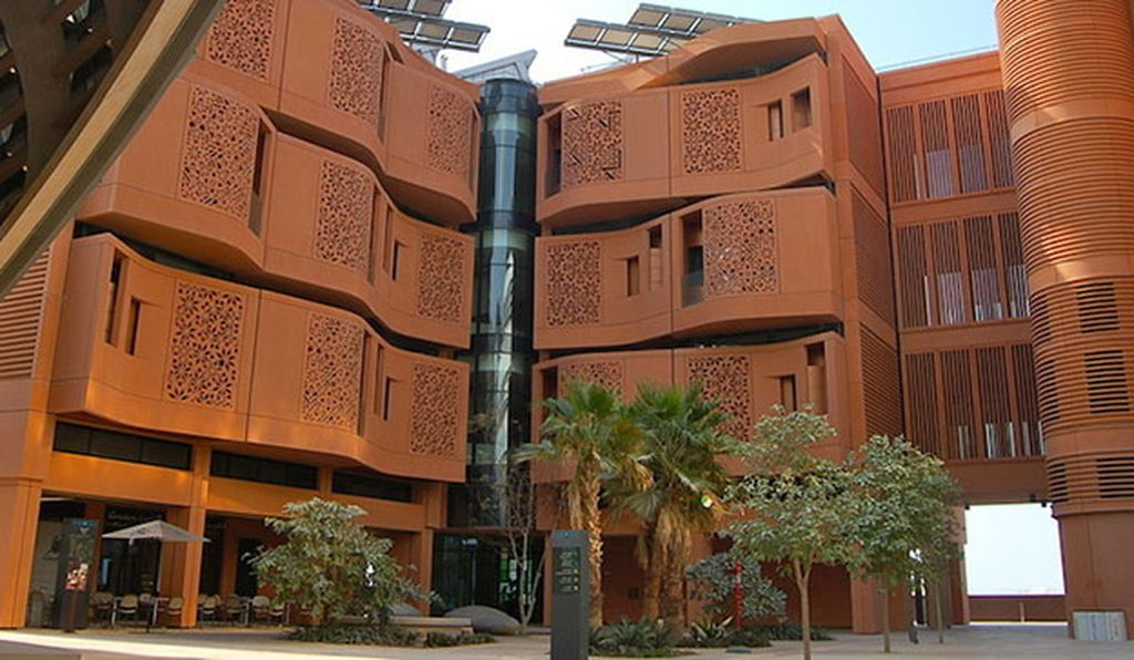 The glass at the Masdar Institute Campus is shielded by terracotta grills.