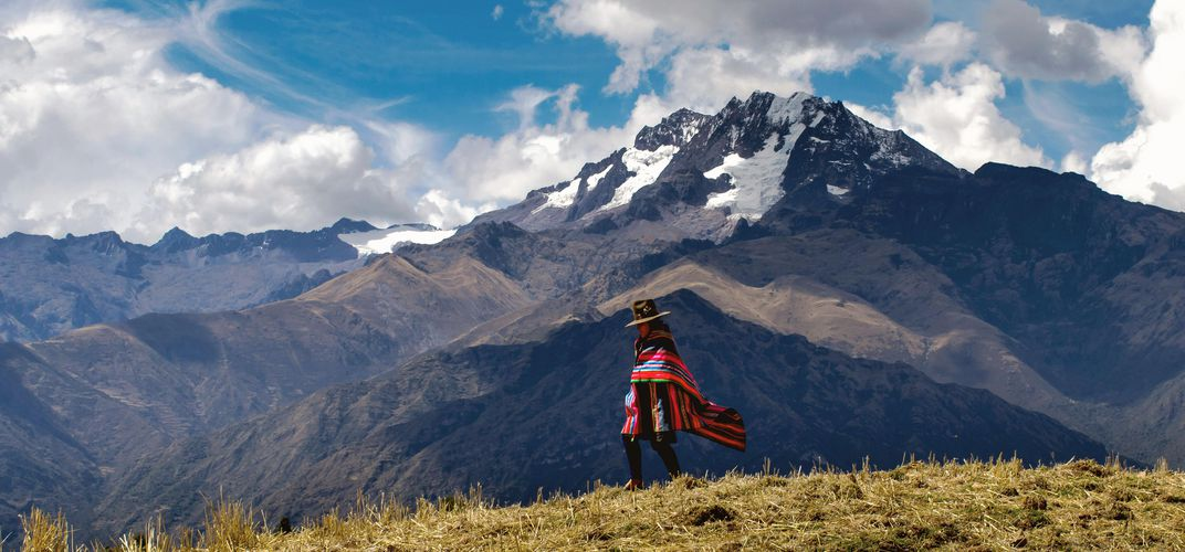 Andean woman walks across a ridge near Chinchero. Credit: Christopher Newman
