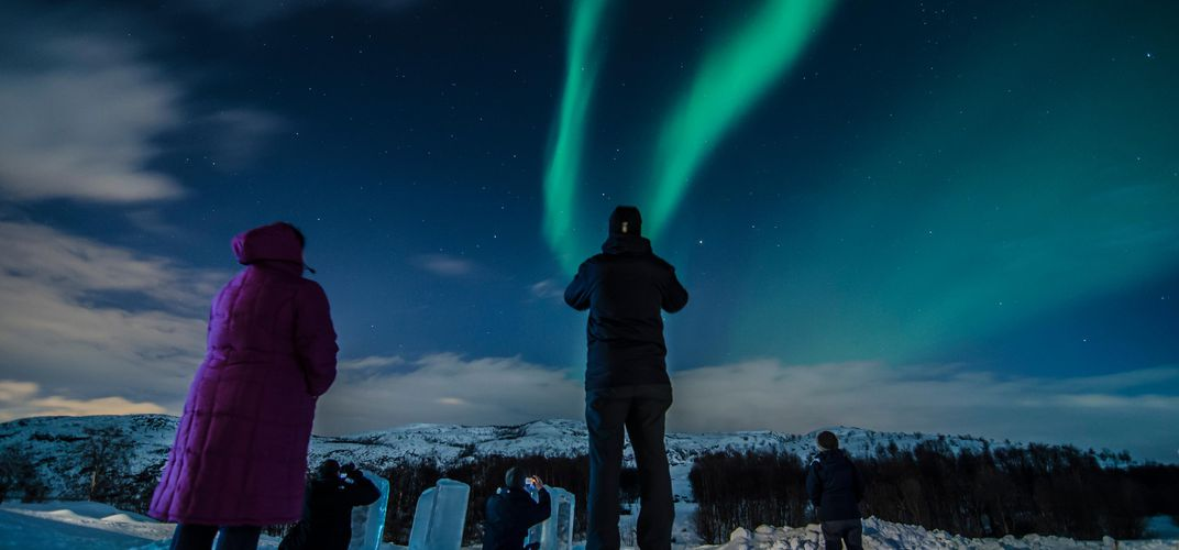 Travelers enjoying the Northern Lights