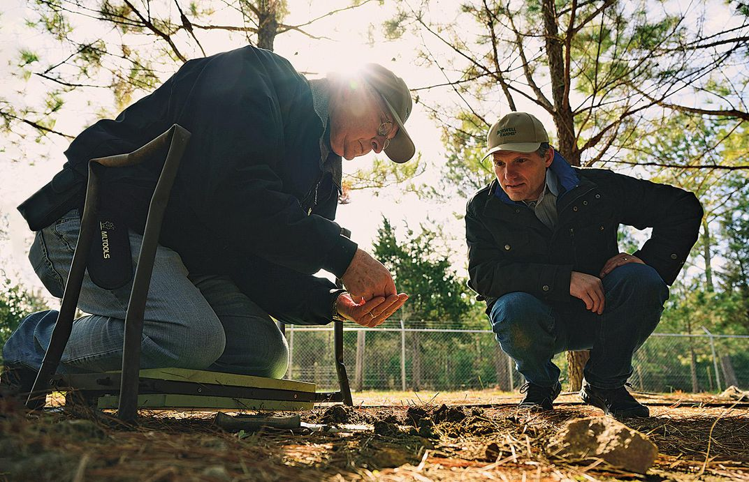 Richard Franks and Jeffrey Coker looking at truffle