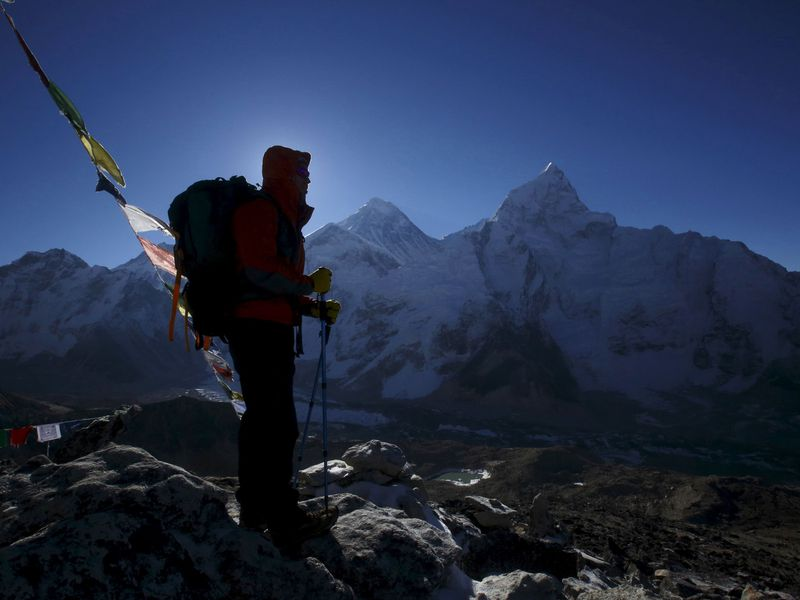 Hiker looking at Mount Everest