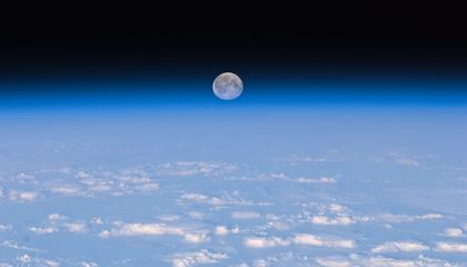 Earth Is Making the Moon All Warm and Soft on the Inside