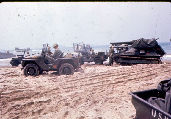 """Jeeps and tanks on the beach ready to 'attack.'"""