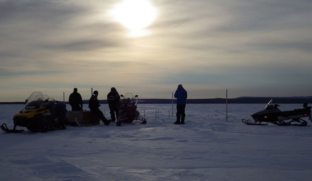 North West River community sea-ice specialists and SmartICE researchers install a sea-ice thickness monitoring station.