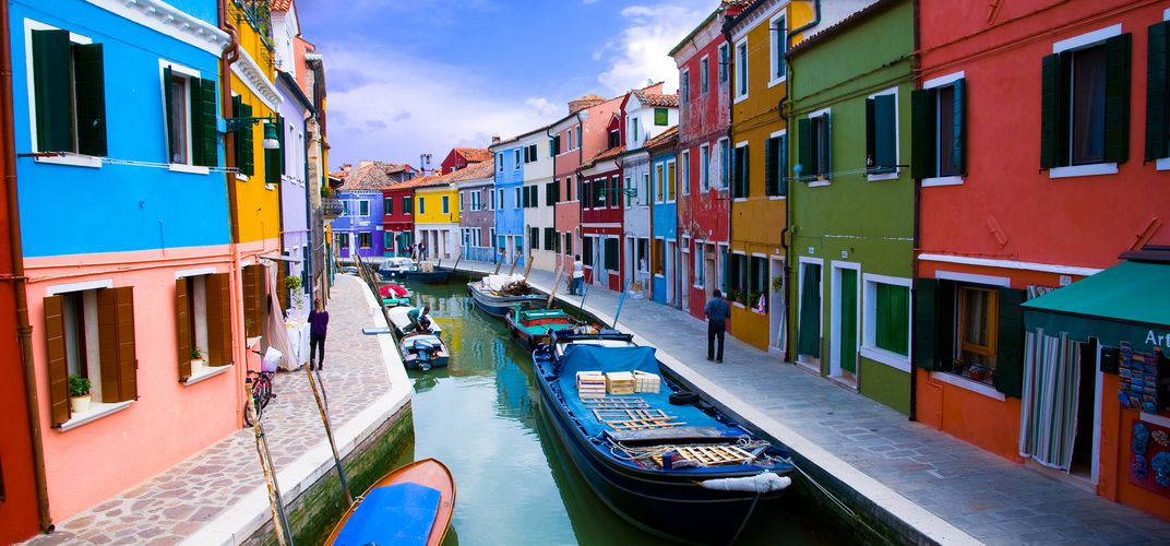 Colorful homes along a canal in the fishing village of Burano