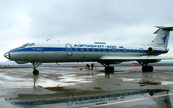 Passengers in Russia give a plane a push