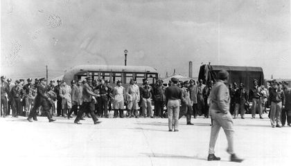 The 101 African American officers arrested at Freeman Field about to be transported to Goodman Field, Kentucky. This image was likely taken with a hidden camera by Master Sergeant Harold J. Beaulieu, Sr. Other photographs of the event taken by another African American enlisted man were destroyed by a white officer on the spot.
