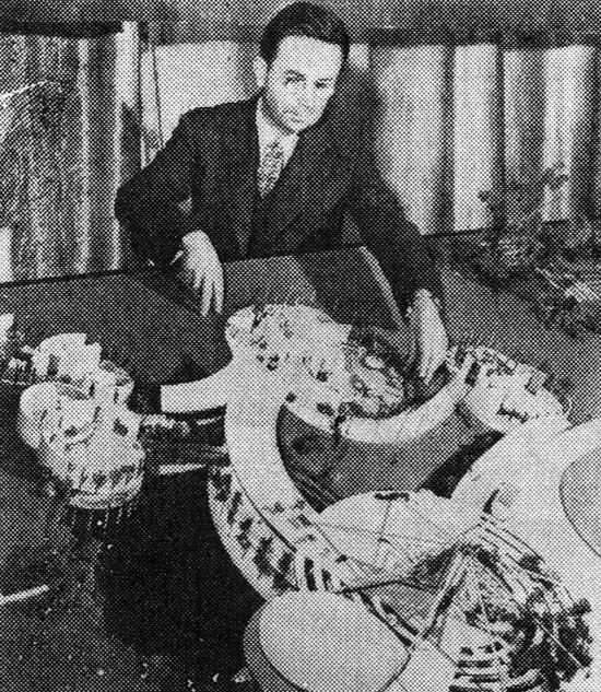 Alden B. Down with a plastic house he designed (1944)
