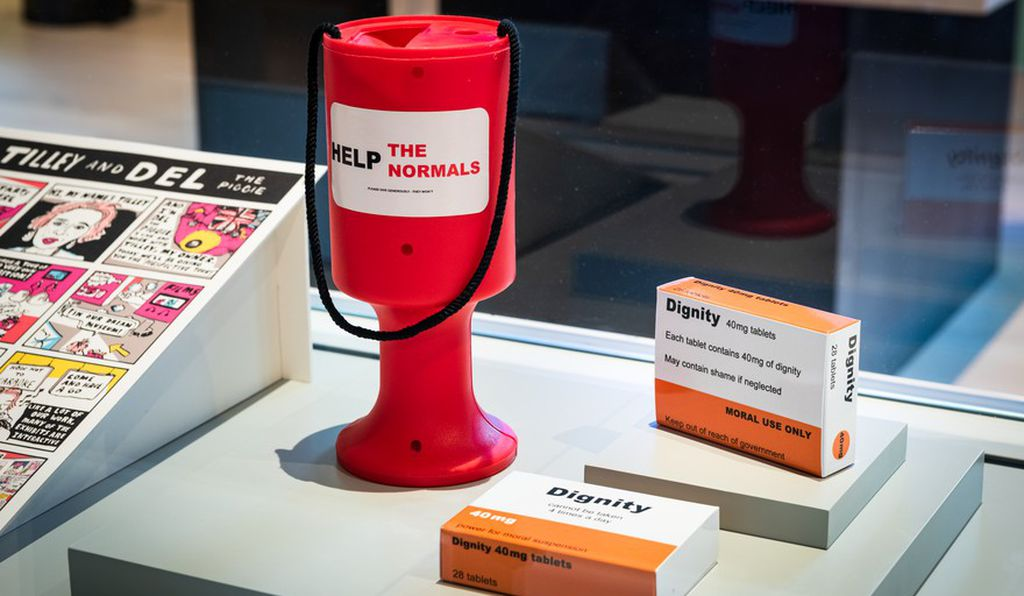 """Dolly Sen's """"Dignity"""" features a prescription pill box that proclaims, """"Dignity cannot be taken 4 times a day"""""""