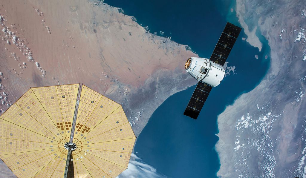 In 2016, a SpaceX Dragon capsule draws close to the International Space Station. Ridings oversaw the Dragon's first trip to the station in 2012.
