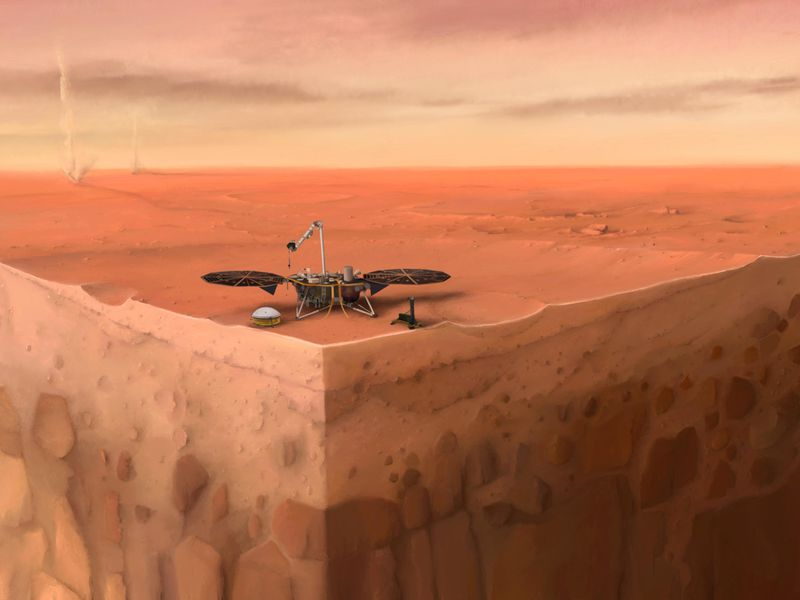 An artist's rendering of InSight. It looks like the robot is sitting atop a piece of land that has been sliced to look like a corner, revealing the layers underneath the surface. The background depicts Mars' red, rocky surface before a yellow sky.