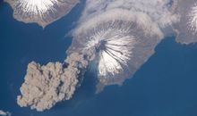Space station astronauts catch an Alaskan volcano blowing its stack.
