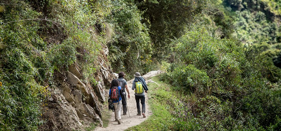 Hikers along a trail in the Sacred Valley