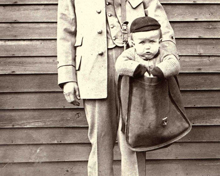 bb20779820e3c Uniformed Letter Carrier with Child in Mailbag (Smithsonian Institution)