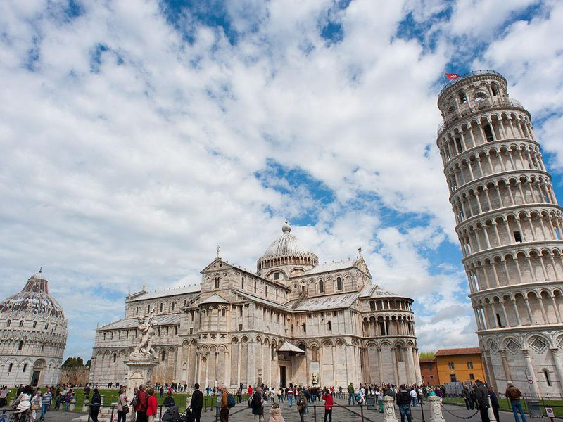 1280px-Panoramic_view_of_Piazza_dei_Miracoli_(-Square_of_Miracles-)._Pisa,_Tuscany,_Central_Italy.jpg