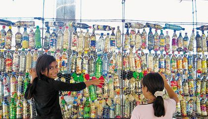 Children at bottle wall