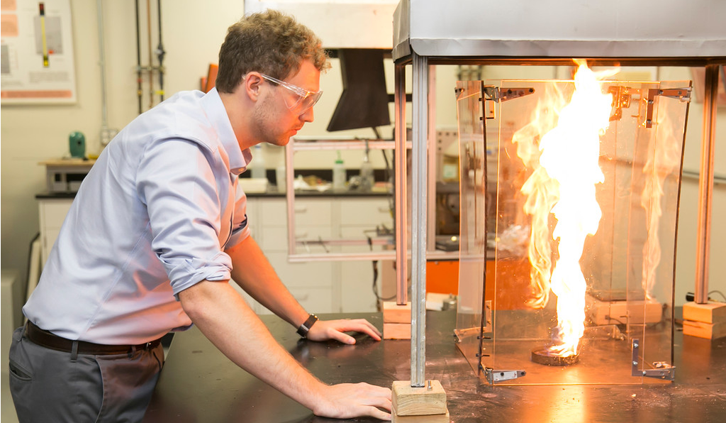 Taylor Myers, coinventor of the Mulciber Stove, at work in the lab at the University of Maryland. The Mulciber is one of a new, high-tech breed of wood stoves that advocates say can be cleaner and greener than other forms of heat.