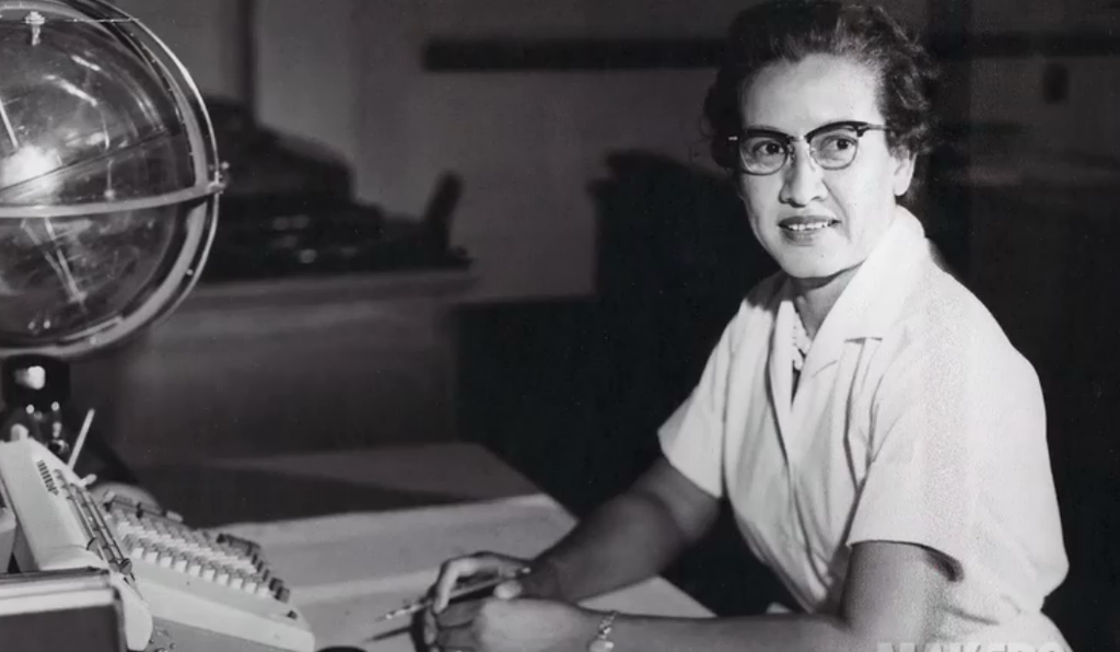 Katherine Johnson at her desk at Langley with a