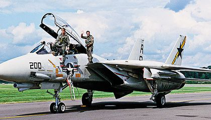 Dale Snodgrass is known as a virtuoso of the F-14 (left, with squadron ops officer Dirk Hebert at right, in 1990).
