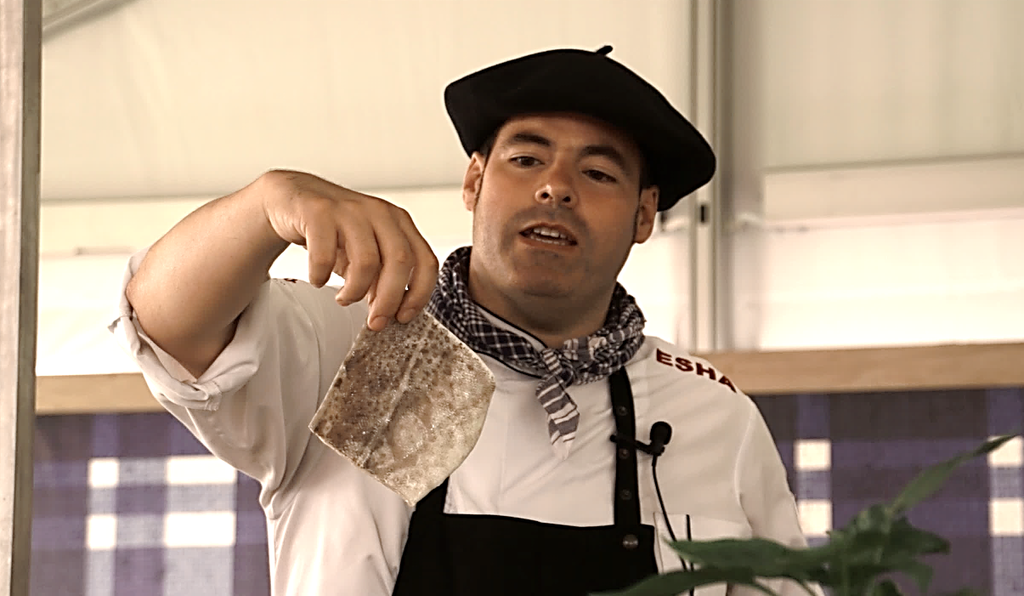 Chef Ozamiz Goiriena displays a loin of salt cod that has been soaked and rehydrated in cold water.