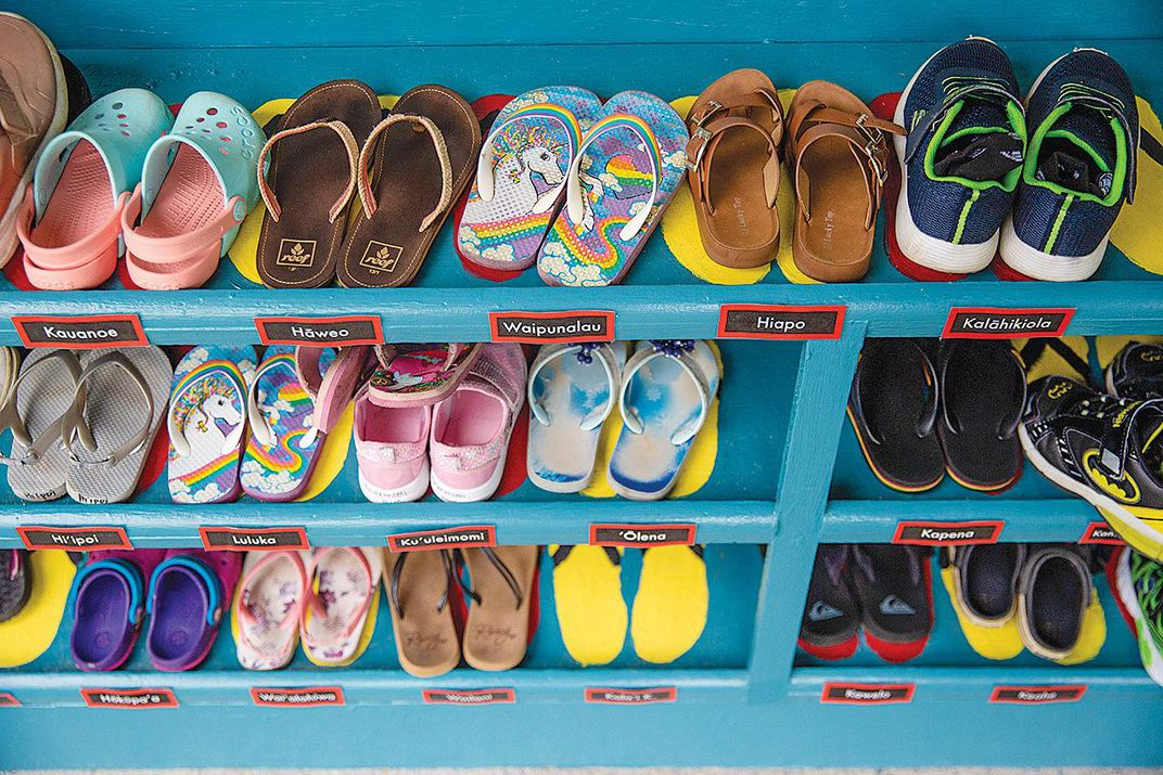 A shoe rack with children's shoes