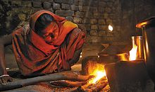 Woman and open fire stove