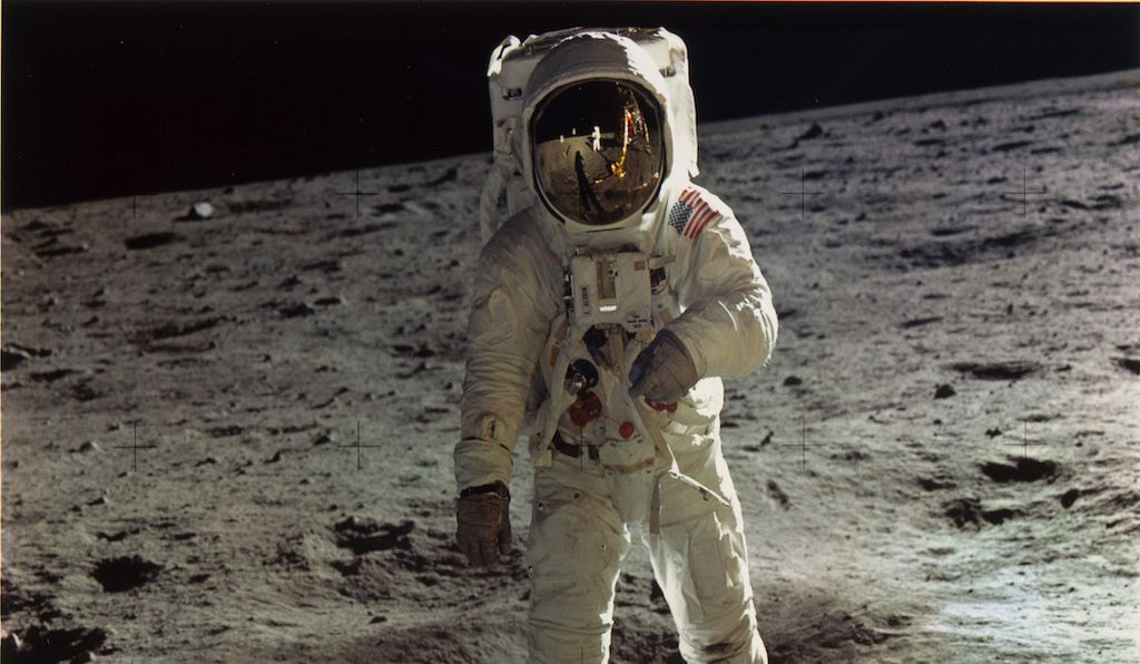 Buzz Aldrin walking on the surface of the moon near a leg of the Lunar Module, 1969, printed later.
