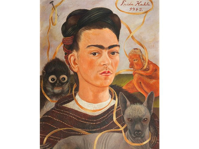 Kahlo makes eye contact with the viewer in this portrait of her head; she is encircled by a golden ribbon, a gray dog, a monkey and a folk art-inspired statue behind her shoulder