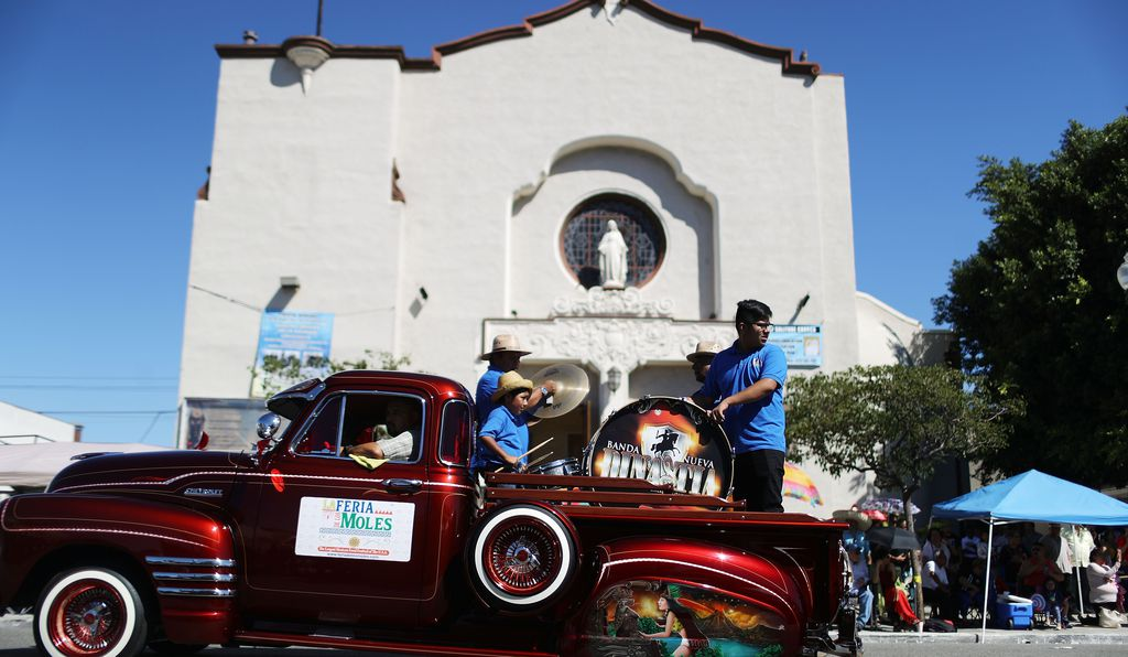 Revelers parade in a lowrider during the 72nd annual East LA Mexican Independence Day Parade on September 16, 2018 in Los Angeles, California.