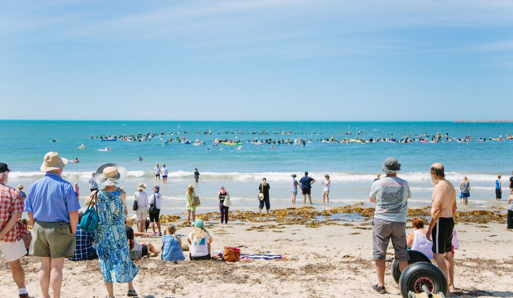 A crowd forms a circle in the protected waters of Encounter Bay to peacefully protest the Oceanic Victor tuna attraction.