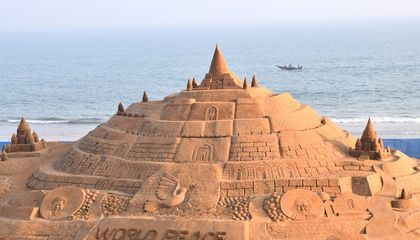Image: These photos show just how colossal the world's tallest sandcastle is