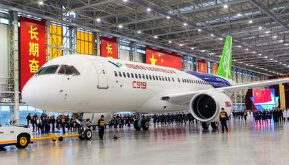 China Rolls Out New Passenger Jet to Compete With Boeing and Airbus