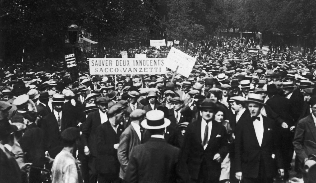 A crowd in France gathers to show their support for Sacco and Vanzetti's appeal two days before their scheduled execution.