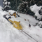 Plow train at the ready; outdoor model railroad in the Pennsylvania winter.