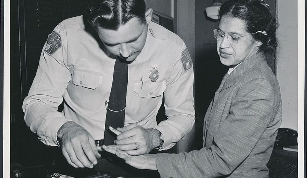Rosa Parks being fingerprinted after refusing to yield her bus seat to a white man