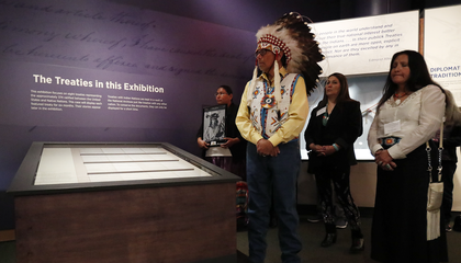 Ramey Growing Thunder (Fort Peck Sioux and Assiniboine Tribes), Chief John Spotted Tail (Rosebud Sioux Tribe), Carolyn Brugh (Fort Peck Sioux and Assiniboine Tribes), and Tamara Stands and Looks Back–Spotted Tail (Rosebud Sioux Tribe) take part in a ceremony at the National Museum of the American Indian honoring the Treaty of Fort Laramie. Ms. Growing Thunder holds a photograph of Medicine Bear (Yanktonai Band of Sioux), one of the Native leaders who signed the treaty 150 years ago. Delegations from the Yankton Sioux Tribe, Oglala Sioux Tribe, and Northern Arapaho Tribe also traveled to Washington, D.C., for the installation of the treaty in the exhibition