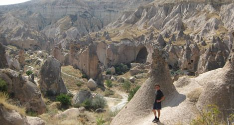 The author stands amidst weirdness in the Cappadocian village of Zelve.