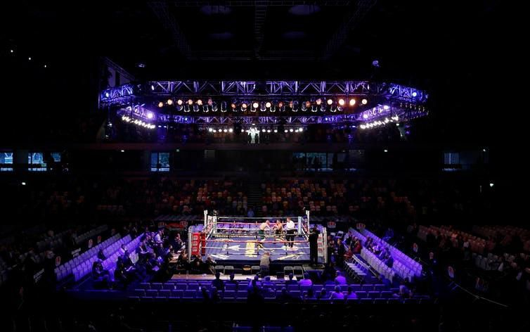 A boxing match takes place in London's Copper Box Arena in 2013.