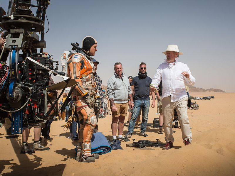 Damon and director Ridley Scott (far right) on location in Jordan (Aidan Monaghan:20th Century Fox).jpg