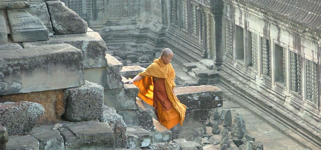 Monk at Angkor Wat. Credit: Chris Palmer