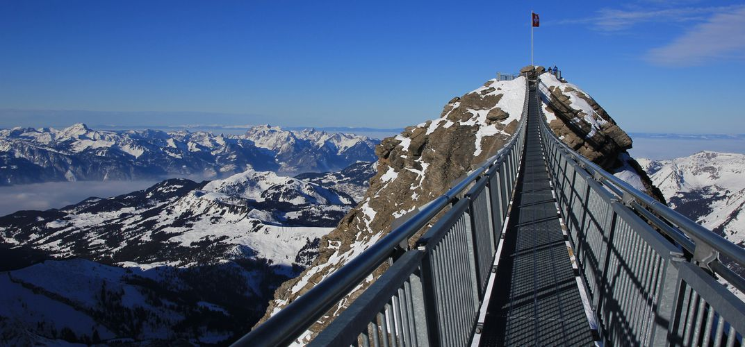 Hiker's suspension bridge spanning Alpine ridges