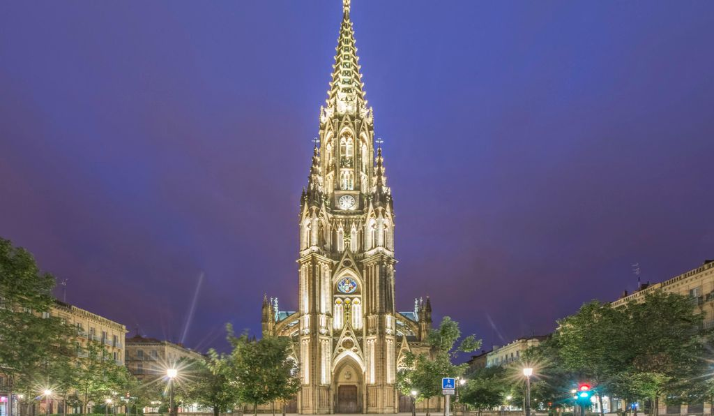 The San Sebastián Cathedral is one of the tallest buildings in the city and contains a crypt, an organ, and elaborate stained-glass windows.