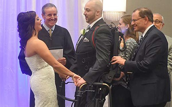 Robotic device helps bionic groom walk down aisle