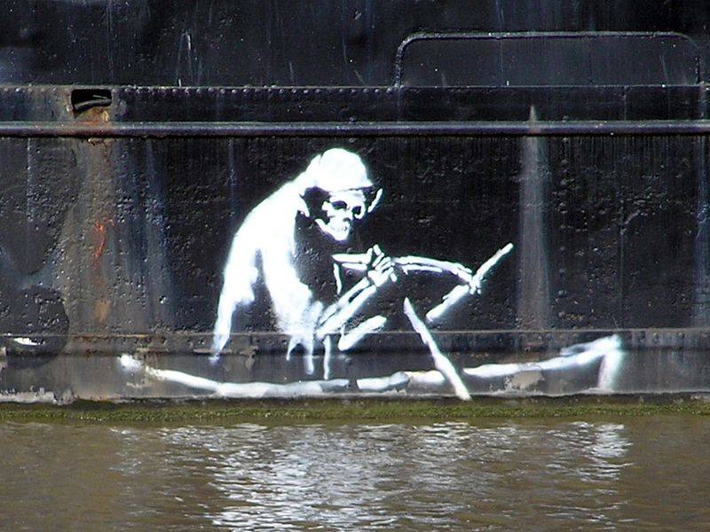 Stencil by Banksy on the waterline of The Thekla