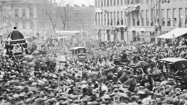 Crowds greet Lincoln's body in 1865 as it's carried through Buffalo, New York.