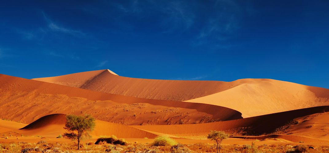 The red ochre sands and blue sky of Namibia's Sossusvlei