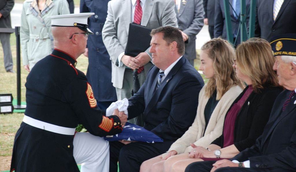 Tye's great-nephew David Tincher being presented with a folded American flag.