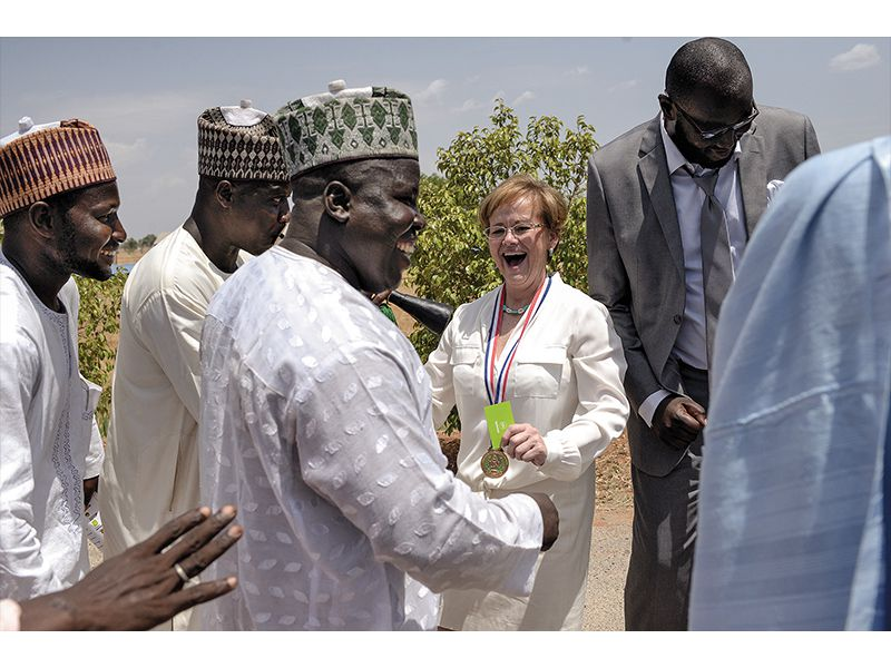 """Ensign (at graduation in June) oversees 1,500 students and faculty from 30  nations. She describes Nigeria as """"the big challenge"""" of her life."""