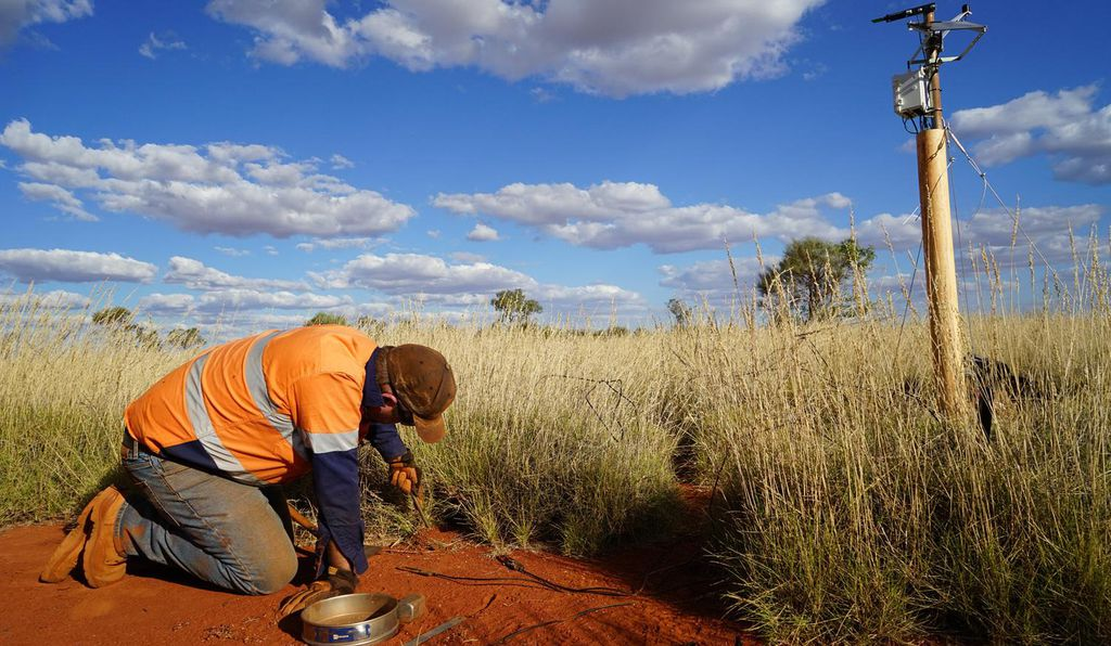 Dr. Todd Erickson from the University of Western Australia installs soil-moisture sensors in the interior of a fairy circle.