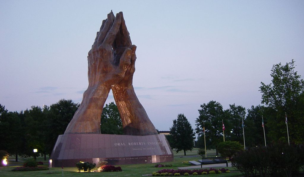The <i>Praying Hands</i> statue at Chau's alma mater, Oral Roberts University